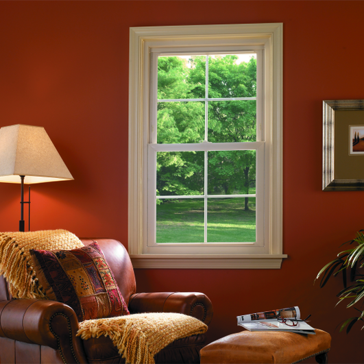 Home Window Replacement in San Antonio with red walls and arm chair